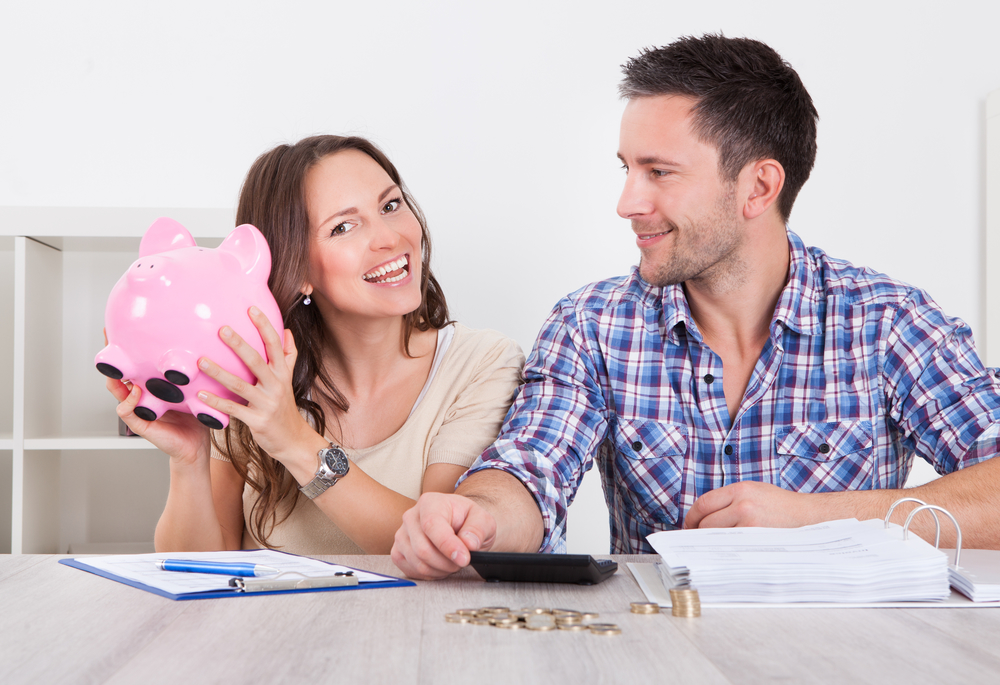 Happy young couple calculating their water softener savings